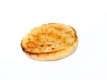 bredd smör på muffin Arkivbild