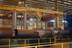 Breech production on ferrous metallurgy. Big diameter steel pipes production in ferrous metallurgy work by weld machine Stock Photography