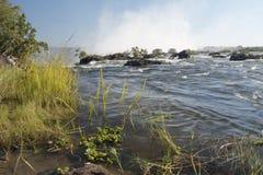 Breed meningslandschap als achtergrond bovenop Victoria Falls, Livingstone, Zambia Stock Afbeeldingen