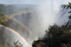 Breed meningslandschap als achtergrond, Regenboog van Victoria Falls, Zambia Stock Afbeelding