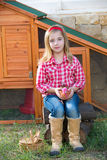 Breeder hens kid girl rancher farmer with chicks in chicken coop Royalty Free Stock Images