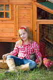 Breeder hens kid girl rancher farmer with chicks in chicken coop Stock Photos