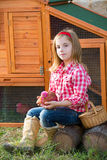 Breeder hens kid girl rancher farmer with chicks in chicken coop Royalty Free Stock Photography