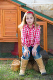 Breeder hens kid girl rancher farmer sitting in chicken tractor Royalty Free Stock Photography