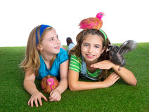 Breeder hens kid sister farmer girls having fun with chicken chi Royalty Free Stock Photography