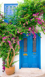 Breek blue door. Greece Hallmark  of blue door with flower Stock Image