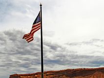 In the Breeze. Flag of The United States of America Waving in the Breeze Before a Storm Rolls In royalty free stock photography
