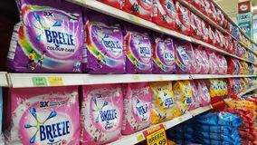 Breeze powder detergent stacked on shelves. JOHOR BAHRU, MALAYSIA- JAN 03, 2019: Breeze powder detergent stacked on shelves on supermarket stand. Breeze was royalty free stock photos
