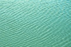 The breeze waves the water and forms waves.  royalty free stock image