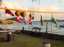 A breezy afternoon on the windward side of bequia. Flags flapping in a stiff breeze as seen at a small fishing village in the caribbean stock photo