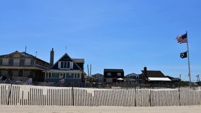 Breezy point homes queens new york oceanfront private beach. There is oceanfront homes of Breezy Point, which is a neighborhood in the New York City borough of royalty free stock photo
