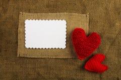 Breiende harten op de jute Royalty-vrije Stock Foto