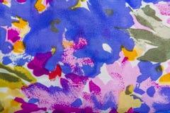 Breigoedstof met bloemen kleurrijk abstract patroon Stock Foto