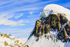 Breithorn with group of ski alpinist on the top. Royalty Free Stock Photography
