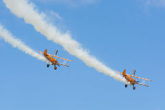 Breitling wingwalkers aerobatic team. Flying two Boeing Stearman biplanes with women on top of the wing over Malmen air base in sweden stock images
