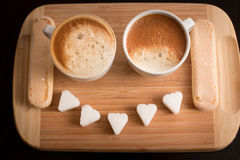 Brekker coffee with smile sugar on wood board and two biscuits Stock Photography