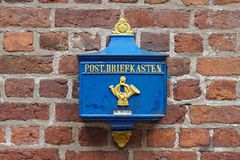 Bremen, Germany - July 10th, 2018 - Vintage German blue mailbox with golden lettering Stock Photography