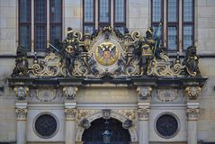 Bremen, Germany - November 7th, 2017 - Richly ornamented pediment above the main entrance to the Chamber of Commerce with golden l Stock Images
