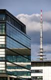 Bremen, Germany - October 7th, 2018 - Modern office building with reflecting glass facade in the Uberseestadt district with radio stock photo