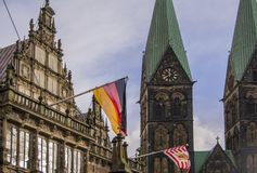 Bremen, Germany. View of the city hall and the Cathedral. On the town hall flags of Germany and the city of Bremen are installed. stock image