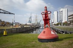 Bremerhaven - Buoy and residential tower at the inner city Royalty Free Stock Image