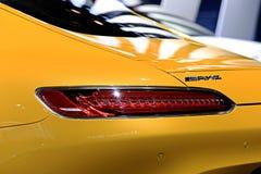 Bremslicht gelben Mercedes Benz-Sportwagens Stockfotografie
