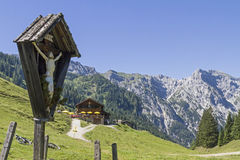 Bärenbadalm and wooden cross Stock Image
