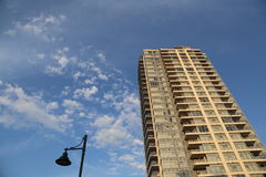 Brend new high rise building against blue sky Stock Photo