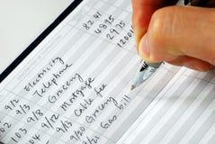 Breng het controleboek voor de lopende rekening in evenwicht Stock Fotografie