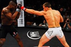 Brennan Ward v. Harley Beekman, MMA. Brennan Ward throws a punch at Harley Beekman during their match stock image