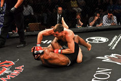 Brennan Ward v. Harley Beekman, MMA. Brennan Ward throws a punch at Harley Beekman during their match Stock Photography