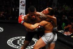 Brennan Ward v. Harley Beekman, MMA. Brennan Ward throws a punch at Harley Beekman during their match royalty free stock image