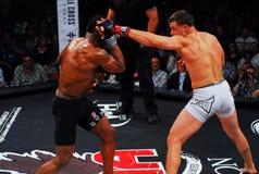 Brennan Ward v. Harley Beekman, MMA. Brennan Ward throws a punch at Harley Beekman during their match royalty free stock images