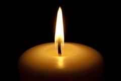 Brennende Kerze. Stockfoto