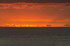 Brennende orange Wolken Lizenzfreie Stockbilder