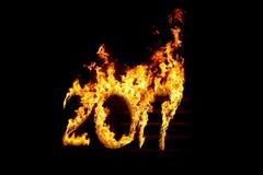 Brennende Zahlen 2017, als das Symbol des Endes des Jahres Lizenzfreie Stockbilder