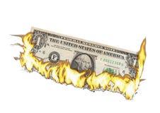 Brennender Dollar Stockbild