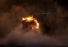 Brennender Reiter ein Viererkabelfahrrad Stockbild