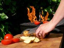Brennendes draußen kochen Stockfotografie