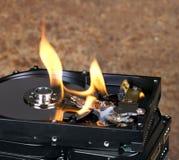 Brennendes Festplattenlaufwerk Stockbild