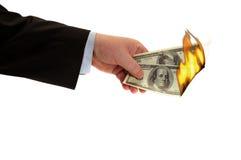 Brennendes Geld Stockbild