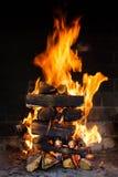 Brennendes Holz Stockbilder