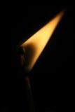 Brennendes Match auf dem Schwarzen Lizenzfreie Stockfotografie