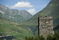 Brenner scenic Switzerland. Scenic view of commune of Brenner in Bolzano-Bozen province, Switzerland. Ruined tower in foreground and Alps mountains in background royalty free stock image