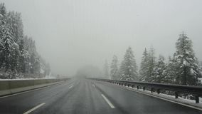 Brennero motorway. Driving shot, driver point-of-view. Footage driving on highway during a snowfall.  stock video footage