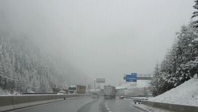 Brennero motorway, Italy. Driving shot, driver point-of-view. Footage driving on highway during a snowfall.  stock video