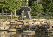 `Brent`s Arch` by Harry Gordon, Hall Park, Frisco, Texas. Pictured is a black granite sculpture by Harry Gordon titled `Brent`s Arches`. It was created in 1992 stock photos
