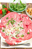 Bresaola, arugula and Parmesan Royalty Free Stock Photos