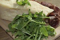 Bresaola arugula and parmesan Stock Photos