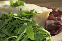 Bresaola arugula and parmesan Royalty Free Stock Images